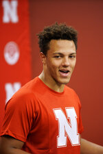 Nebraska quarterback Adrian Martinez smiles during a news conference in Lincoln, Neb., Monday, Aug. 26, 2019. No. 24 Nebraska is in the preseason Top 25 for the first time since 2014, and a big reason for the positive vibe is Martinez, who last season was the most productive freshman quarterback in the nation. (AP Photo/Nati Harnik)