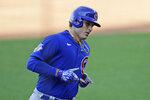 Chicago Cubs' Anthony Rizzo rounds the bases after hitting a solo home run in the third inning in a baseball game against the Cleveland Indians, Wednesday, Aug. 12, 2020, in Cleveland. (AP Photo/Tony Dejak)