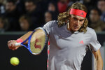 Stefanos Tsitsipas of Greece returns the ball to Fabio Fognini of Italy at the Italian Open tennis tournament, in Rome, Thursday, May 16, 2019. (AP Photo/Andrew Medichini)