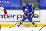 Buffalo Sabres forward Jack Eichel (9) controls the puck during the second period of an NHL hockey game against the New Jersey Devils, Sunday, Jan. 31, 2021, in Buffalo, N.Y. (AP Photo/Jeffrey T. Barnes)