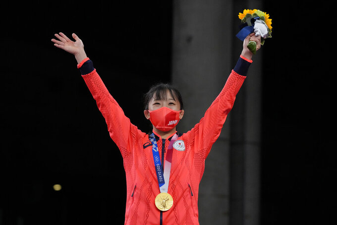 Japan's Yui Susaki celebrates with her gold medal during the victory ceremony for women's freestyle 50kg wrestling at the 2020 Summer Olympics, Saturday, Aug. 7, 2021, in Chiba, Japan. (AP Photo/Aaron Favila)