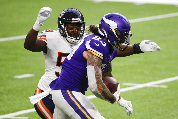 Minnesota Vikings tight end Tyler Conklin (83) runs from Chicago Bears linebacker Roquan Smith, left, during a 20-yard touchdown reception in the second half of an NFL football game, Sunday, Dec. 20, 2020, in Minneapolis. (AP Photo/Bruce Kluckhohn)