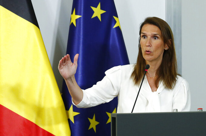 Belgium's Prime Minister Sophie Wilmes talks during a news conference following a meeting of the National Security Council amid the coronavirus outbreak in Brussels, Monday, July 27, 2020. Belgian Prime Minister Sophie Wilmes unveiled Monday a new set of drastic social distancing measures aimed at avoiding a new general lockdown amid a surge of COVID-19 infections. (Francois Lenoir, Pool Photo via AP)