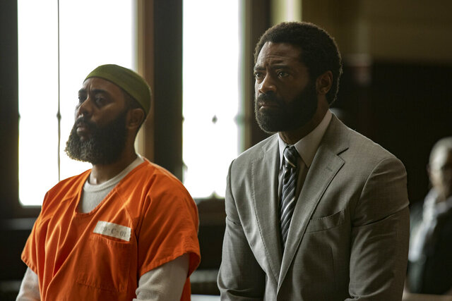 This image released by ABC shows Felonious Munk, left, and Nicholas Pinnock in a scene from