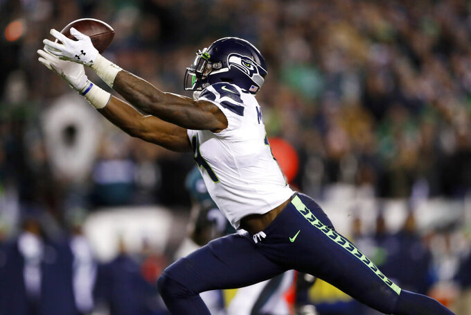 Seattle Seahawks' D.K. Metcalf catches a touchdown pass during the second half of an NFL wild-card playoff football game against the Philadelphia Eagles, Sunday, Jan. 5, 2020, in Philadelphia. (AP Photo/Julio Cortez)