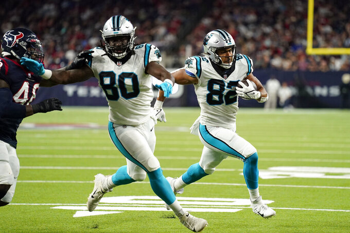 Carolina Panthers tight end Tommy Tremble (82) runs for a touchdown as Ian Thomas (80) blocks Houston Texans' Joe Thomas (48) during the second half of an NFL football game Thursday, Sept. 23, 2021, in Houston. (AP Photo/Eric Christian Smith)
