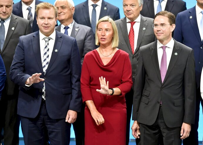 Finnish Minister of Defence Antti Kaikkonen, left, with High Representative of the European Union for Foreign Affairs and Security Policy Federica Mogherini and Finnish Commissioner of Jobs Jyrki Katainen, pose for a photo of the Informal Meeting of EU Defence Ministers in Helsinki, Finland, on Thursday, Aug. 29, 2019.  The topics for discussions of the meeting include artificial intelligence and the effect of climate change on defence and security. (Jussi Nukari/