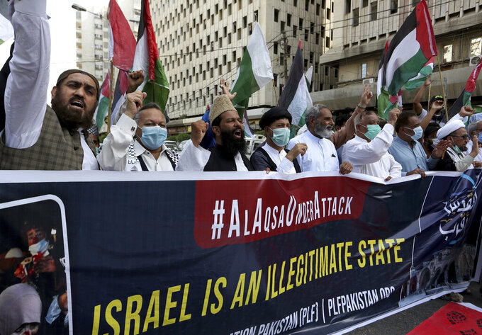 Members of a civil society group chant anti-Israeli slogans during a demonstration in support of Palestinians during the latest round of violence in Jerusalem, in Karachi, Pakistan, Tuesday, May 11, 2021. (AP Photo/Fareed Khan)
