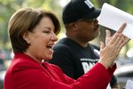 Sen. Amy Klobuchar, D-Minn., left, and Cliff Albright, executive director of Black Voters Matter, attend a rally for voting rights, Tuesday, Sept. 14, 2021, on Capitol Hill in Washington. (AP Photo/Jacquelyn Martin)