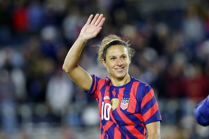 United States' forward Carli Lloyd waves to fans after a soccer friendly match against South Korea, Tuesday, Oct. 26, 2021, in St. Paul, Minn. (AP Photo/Andy Clayton-King)