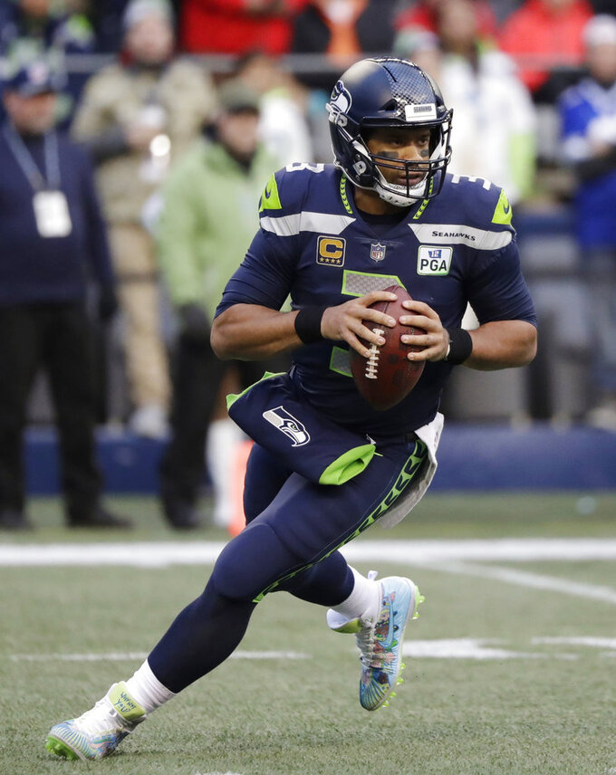 FILE - In this Dec. 2, 2018, file photo, Seattle Seahawks quarterback Russell Wilson drops back to pass against the San Francisco 49ers during the second half of an NFL football game in Seattle. Wilson is five seasons removed from raising the Lombardi Trophy, but is coming off a season where he set career highs in touchdown passes (35) and passer rating (110.9) while running less than he has at any other point in his career. (AP Photo/Elaine Thompson, File)