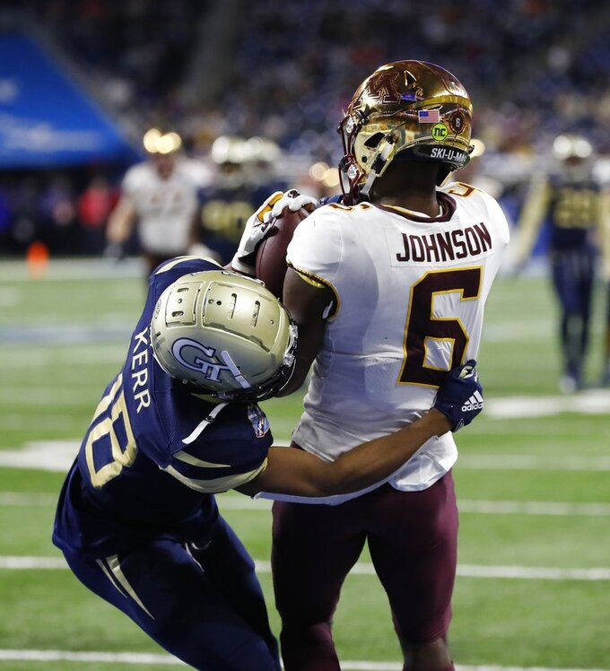 Minnesota wide receiver Tyler Johnson (6), defended by Georgia Tech defensive back Ajani Kerr (38), catches a pass for a touchdown during the second half of the Quick Lane Bowl NCAA college football game, Wednesday, Dec. 26, 2018, in Detroit. (AP Photo/Carlos Osorio)