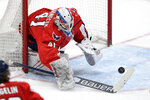 Washington Capitals goaltender Vitek Vanecek (41) reaches for the puck during the second period of the team's NHL hockey game against the New York Rangers, Friday, March 19, 2021, in Washington. (AP Photo/Nick Wass)
