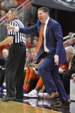 Clemson head coach Brad Brownell touts instructions to his team during the second half of an NCAA college basketball game against Louisville in Louisville, Ky., Saturday, Feb. 16, 2019. Louisville won 56-55. (AP Photo/Timothy D. Easley)