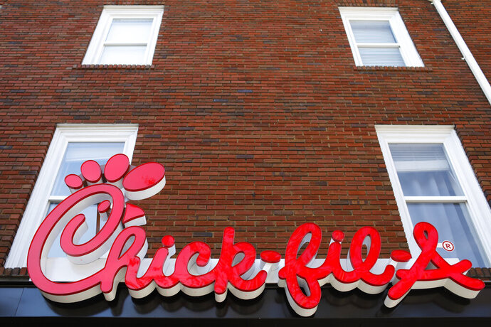 FILE - In this Oct. 30, 2018 file photo, Chick-fil-A signage is displayed in downtown, Athens, Ga. Chick-fil-A said Monday, Sept. 14, 2020, that it no longer plans to open a restaurant in the San Antonio airport, even though the Texas city relented and agreed to let it do so after more than a year of legal wrangling. (Joshua L. Jones/Athens Banner-Herald via AP, File)