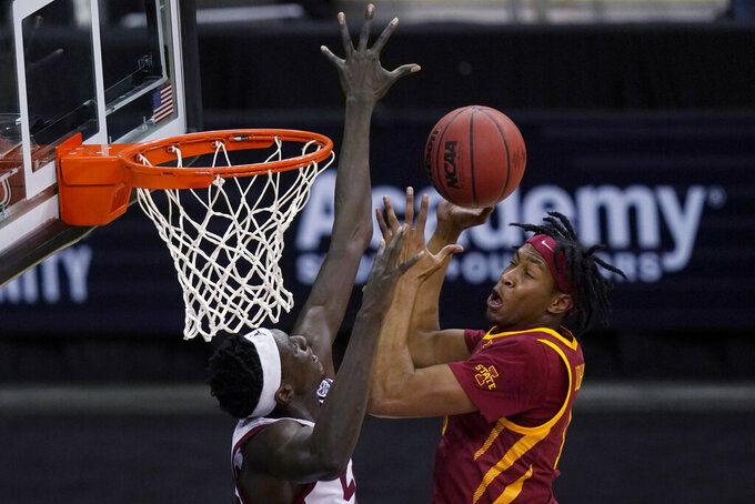 Iowa State forward Javan Johnson, right, shoots over Oklahoma forward Kur Kuath during the second half of an NCAA college basketball game in the first round of the Big 12 men's tournament in Kansas City, Mo., Wednesday, March 10, 2021. (AP Photo/Orlin Wagner)