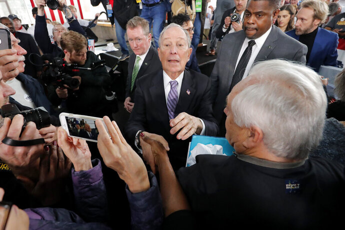 Democratic presidential candidate and former New York City Mayor Mike Bloomberg greets supporters after speaking at a campaign event in Raleigh, N.C., Thursday, Feb. 13, 2020. (AP Photo/Gerald Herbert)