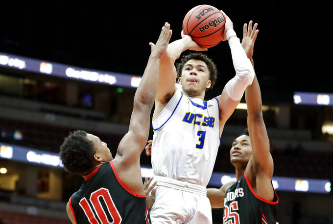 UC Santa Barbara guard JaQuori McLaughlin shoots between Cal State Northridge guard Darius Brown II, left, and forward Jared Pearre during the first half of a NCAA college basketball game at the Big West Conference tournament in Anaheim, Calif., Thursday, March 14, 2019. (AP Photo/Chris Carlson)