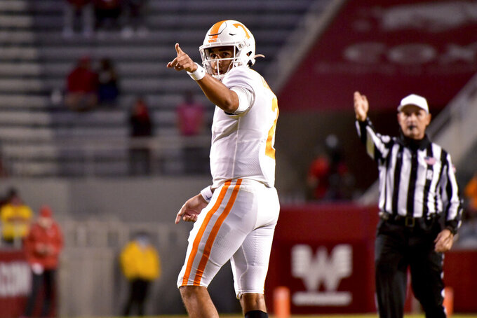 Tennessee quarterback Jarrett Guarantano reacts after a first down against Arkansas during the first half of an NCAA college football game Saturday, Nov. 7, 2020, in Fayetteville, Ark. (AP Photo/Michael Woods)