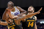 Missouri guard Torrence Watson winces while getting caught on the bottom as LSU forward Darius Days, center, and Missouri forward Reed Nikko (14) battle for position to grab the rebound in the first half of an NCAA college basketball game, Tuesday, Feb. 11, 2020, in Baton Rouge, La. (AP Photo/Bill Feig)