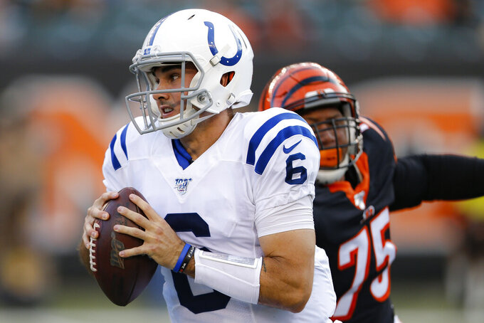 Indianapolis Colts quarterback Chad Kelly (6) looks to pass under pressure from Cincinnati Bengals defensive end Jordan Willis (75) during the first half of an NFL preseason football game Thursday, Aug. 29, 2019, in Cincinnati. (AP Photo/Gary Landers)