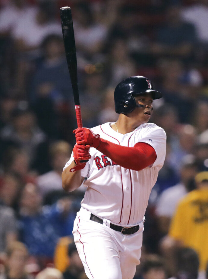 Boston Red Sox's Rafael Devers watches his two-RBI double during the fourth inning of a baseball game agains the Toronto Blue Jays at Fenway Park in Boston, Wednesday, July 17, 2019. (AP Photo/Charles Krupa)