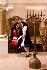In this Saturday, Feb. 1, 2020, photo, Rabbi Jacqueline Mates-Muchin smiles at Hanna Raskin during her bat mitzvah at Temple Sinai in Oakland, Calif. Since an anti-semitic graffiti incident at the temple in 2017 and the subsequent deadly attacks on synagogues in Pittsburgh and in Poway, Calif., Mates-Muchin says there's extra worry as she feels obliged to be constantly mindful of her congregation's safety.  (AP Photo/Noah Berger)