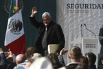 Mexico's President Andres Manuel Lopez Obrador waves to residents during his visit to the small town of La Mora, Sonora state, Mexico, Sunday Jan. 12, 2020. Lopez Obrador said Sunday there is an agreement to establish a monument will be put up to memorialize nine U.S.-Mexican dual citizens ambushed and slain last year by drug gang assassins along a remote road near New Mexico. (AP Photo/Christian Chavez)