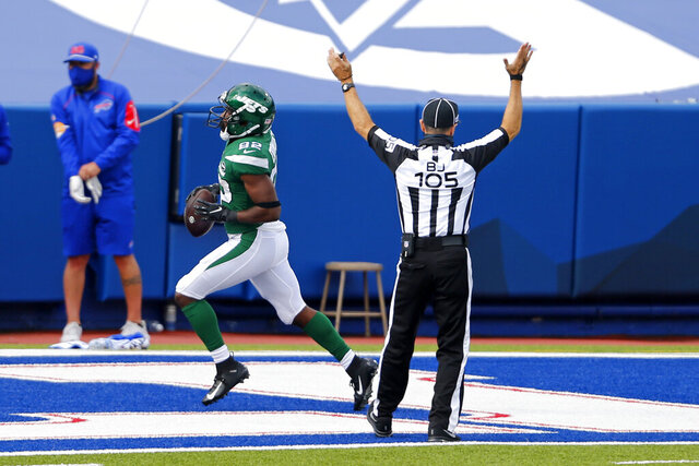 New York Jets wide receiver Jamison Crowder (82) scores after catching a pass from quarterback Sam Darnold during the second half of an NFL football game against the Buffalo Bills in Orchard Park, N.Y., Sunday, Sept. 13, 2020. (AP Photo/Jeffrey T. Barnes)