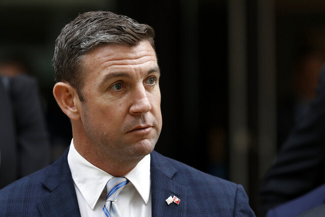 FILE - This Dec. 3, 2019 file photo shows California Republican Rep. Duncan Hunter leaveing federal court in San Diego. Hunter submitted his resignation Tuesday, Jan. 7, 2020, effective Jan. 13, after pleading guilty to a corruption charge, leaving one of the GOP's few remaining House seats in heavily Democratic California. Hunter's departure ends his family's political dynasty in which he and his father, Duncan L. Hunter, represented the San Diego County district for nearly 30 years. (AP Photo/Gregory Bull, File)