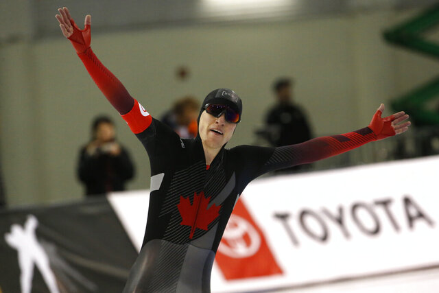 Canada's Graeme Fish celebrates after the men's 10,000 meters during the world single distances speedskating championships Friday, Feb. 14, 2020, in Kearns, Utah. (AP Photo/Rick Bowmer)