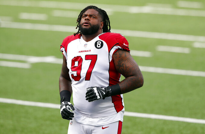 FILE - In this Sunday, Dec. 13, 2020, file photo, Arizona Cardinals defensive end Jordan Phillips (97) warms up before an NFL football game against the New York Giants in East Rutherford, N,J. Seven tackles, seven interior defenders, nine edge rushers and nine linebackers got the hefty contracts with six of the edge rushers cashing in last offseason. That class fell far short of delivering with Robert Quinn, Dante Fowler, Mario Addison, Jordan Phillips, Shaq Lawson and Carl Nassib going from an average of 9.1 sacks the year before hitting the open market to just 3.1 last season in the first year of their new deals. (AP Photo/Noah K. Murray, File)