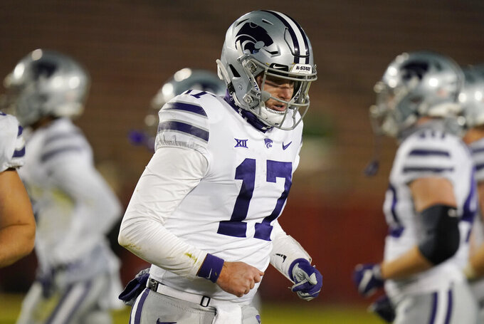 Kansas State quarterback Nick Ast (17) walks off the field after a Kansas State fumble during the second half of an NCAA college football game against Iowa State, Saturday, Nov. 21, 2020, in Ames, Iowa. Iowa State won 45-0. (AP Photo/Charlie Neibergall)