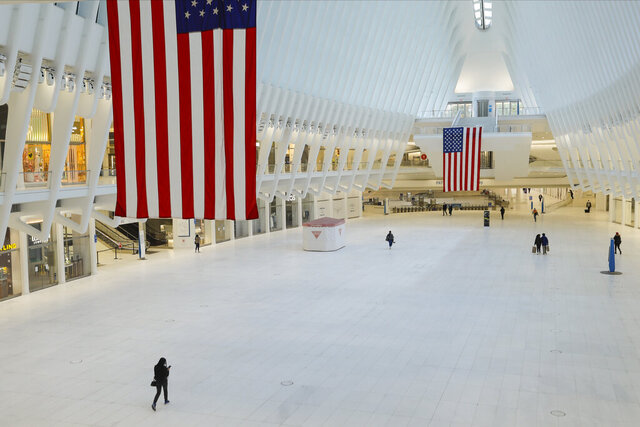 Pedestrians walk through the nearly empty Oculus during the coronavirus pandemic Saturday, May 9, 2020, in New York. (AP Photo/Frank Franklin II)