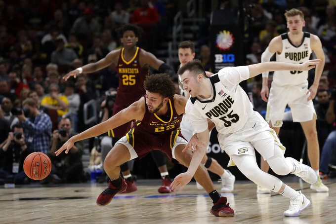 Minnesota's Gabe Kalscheur (22) and Purdue's Sasha Stefanovic (55) battle for a loose ball during the second half of an NCAA college basketball game in the quarterfinals of the Big Ten Conference tournament, Friday, March 15, 2019, in Chicago. (AP Photo/Nam Y. Huh)