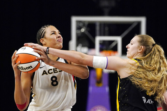 Las Vegas Aces center Liz Cambage, left, tries to shoot as Los Angeles Sparks forward Lauren Cox defends during the second half of a WNBA basketball game Friday, July 2, 2021, in Los Angeles. The Aces won 66-58. (AP Photo/Mark J. Terrill)