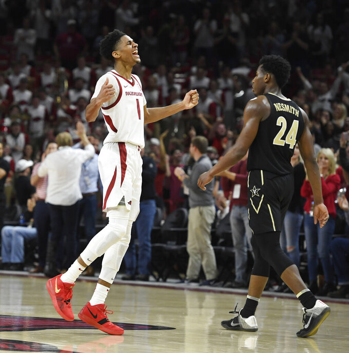 Arkansas guard Isaiah Joe (1) celebrates in front of Vanderbilt forward Aaron Nesmith (24) after a Vanderbilt turnover late in the second half of an NCAA college basketball game, Tuesday, Feb. 5, 2019 in Fayetteville, Ark. (AP Photo/Michael Woods)