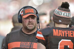 FILE - In this Nov. 4, 2018, file photo, Cleveland Browns offensive coordinator Freddie Kitchens talks to quarterback Baker Mayfield during an NFL football game against the Kansas City Chiefs, in Cleveland. A person familiar with the decision says the Cleveland Browns are hiring Freddie Kitchens as their coach.  Kitchens, who had a dazzling eight-week run as the team's interim offensive coordinator, is finalizing his contract and will be named Cleveland's ninth coach since 1999, said the person who spoke Wednesday, Jan. 9, 2019, to the Associated Press on condition of anonymity because the team is not commenting on the imminent hire. (AP Photo/David Richard, File)