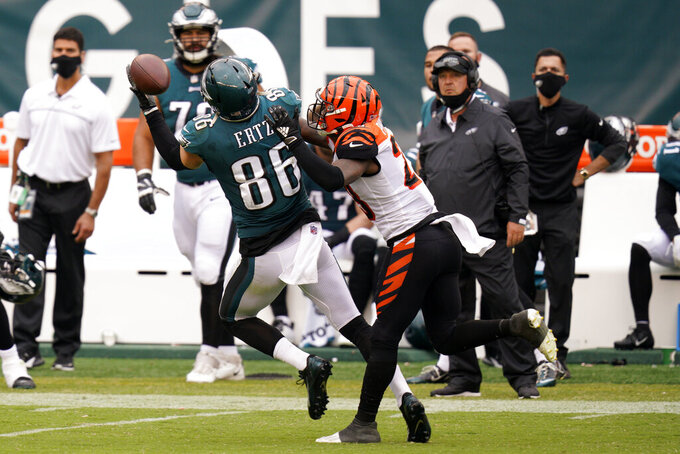 Philadelphia Eagles' Zach Ertz (86) pulls in a pass against Cincinnati Bengals' Darius Phillips (23) during overtime of an NFL football game, Sunday, Sept. 27, 2020, in Philadelphia. (AP Photo/Chris Szagola)