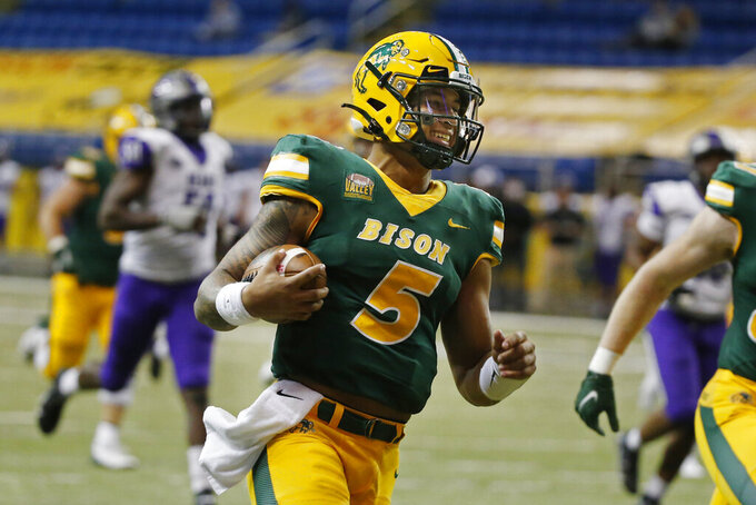 North Dakota State quarterback Trey Lance runs for a touchdown against Central Arkansas in the third quarter of an NCAA college football game Saturday, Oct. 3, 2020, in Fargo, N.D. North Dakota State won 39-28. (AP Photo/Bruce Kluckhohn)