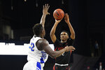 Northeastern guard Tyson Walker (2) shoots against Hofstra forward Isaac Kante (32) during the first half of an NCAA college basketball game for the championship of the Colonial Athletic Association conference tournament Tuesday, March 10, 2020, in Washington. (AP Photo/Nick Wass)