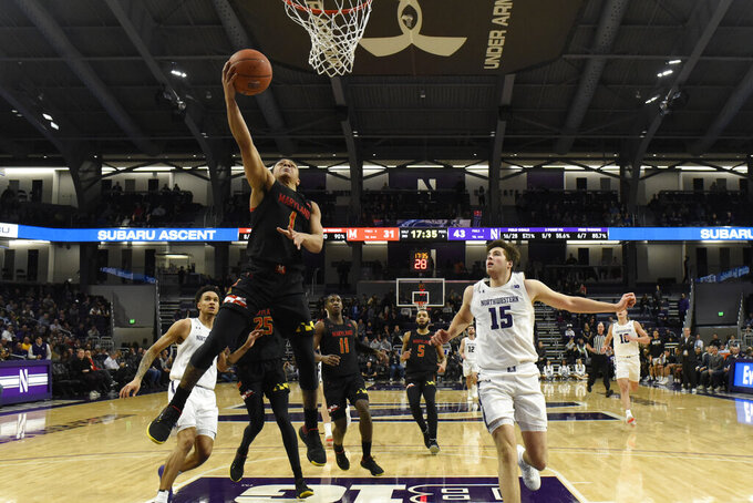 Maryland guard Anthony Cowan Jr. (1) goes to the basket as Northwestern center Ryan Young (15) stands nearby during the second half of an NCAA college basketball game, Tuesday, Jan. 21, 2020, in Evanston, Ill. (AP Photo/David Banks)