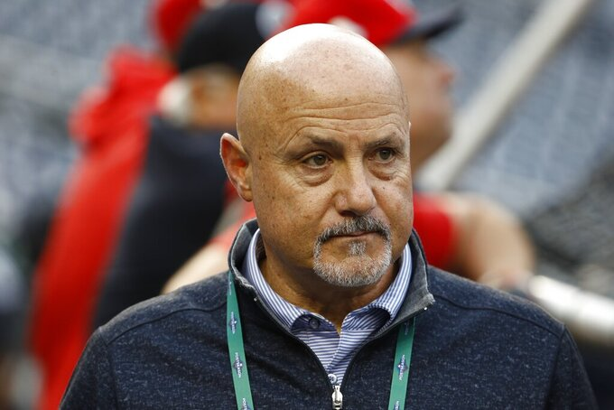 "FILE - In this Oct. 26, 2019, file photo, Washington Nationals general manager Mike Rizzo watches batting practice for Game 4 against the Houston Astros in the baseball World Series in Washington. ""The challenges have been that they stopped playing baseball about six weeks into the spring season,"" Rizzo said, talking about the draft. ""So that's been the biggest hurdle that we had to face. Fortunately, we dive into this draft thing very, very seriously. We got a lot done early on, especially the higher-round type of premier prospects. We have a really good feel of what's out there in the country."" (AP Photo/Patrick Semansky, File)"