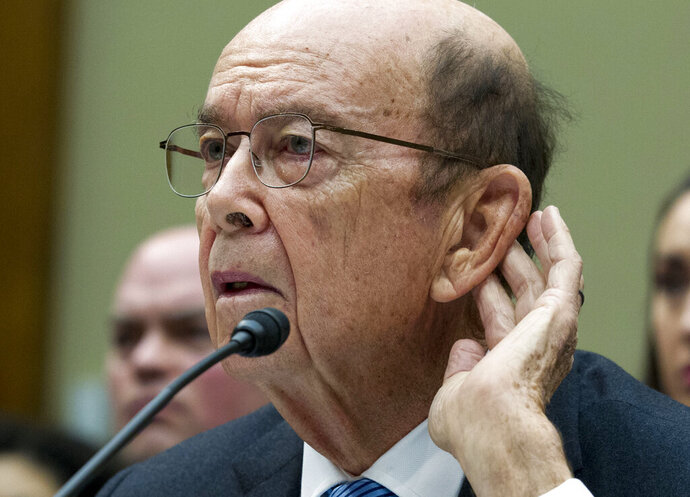 FILE - In this March 14, 2019 file photo Commerce Secretary Wilbur Ross testifies during the House Oversight Committee hearing on Capitol Hill in Washington. New evidence paints a