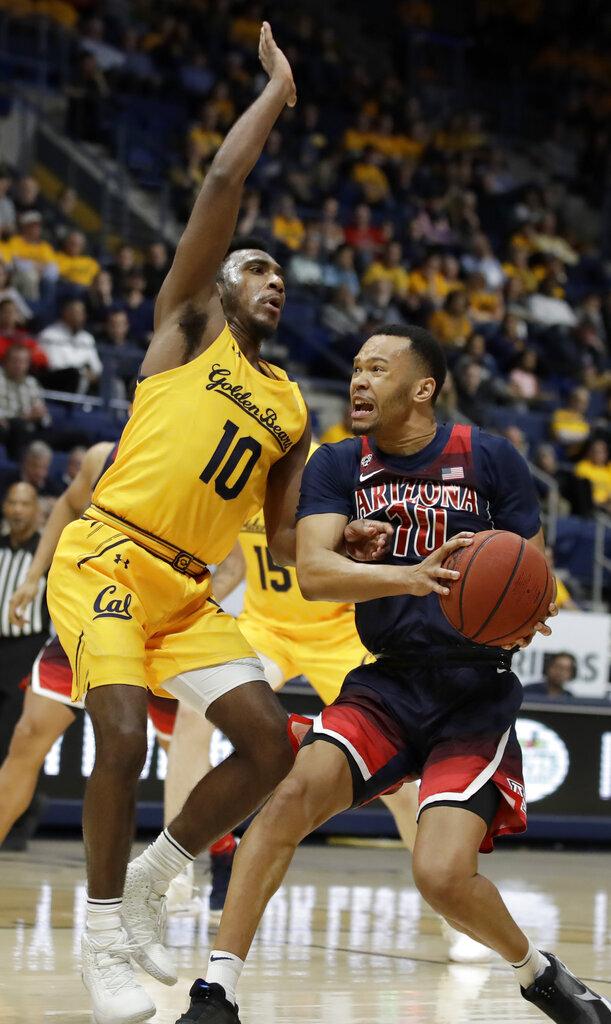 California's Kareem South, left, defends against Arizona's Jemarl Baker Jr. during the second half of an NCAA college basketball game Thursday, Feb. 13, 2020, in Berkeley, Calif. (AP Photo/Ben Margot)