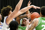 North Texas guard Javion Hamlet, center, looks to pass while defended by Louisiana Tech forward Kenneth Lofton Jr., left, in the first half of an NCAA college basketball game in the Conference USA men's tournament, in Frisco, Texas, Friday, March 12, 2021. (AP Photo/Matt Strasen)