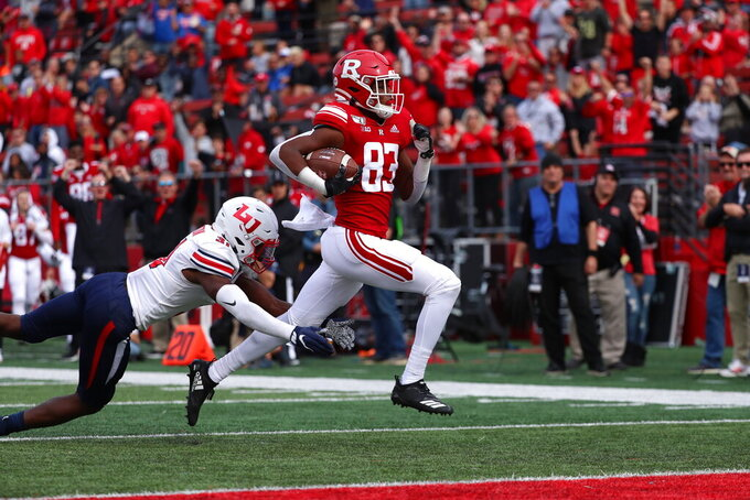 Rutgers wide receiver Isaiah Washington (83) beats Liberty safety Elijah Benton (31) to score a 51-yard touchdown in the third quarter of an NCAA college football game against Rutgers on Saturday, Oct. 26, 2019, in Piscataway, N.J. (Andrew Mills/NJ Advance Media via AP)