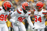 Cleveland Browns defensive end Chad Thomas (92) celebrates with defensive end Olivier Vernon (54) and defensive tackle Sheldon Richardson (98) after sacking Pittsburgh Steelers quarterback Devlin Hodges in the first half of an NFL football game, Sunday, Dec. 1, 2019, in Pittsburgh. (AP Photo/Don Wright)