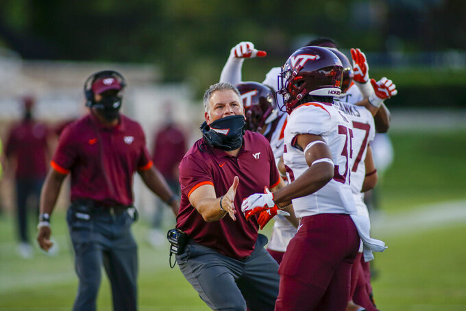 Virginia Tech coach Justin Fuente talks to running back Keshawn King (35) as he leaves the field during the second half of the team's NCAA college football game against Duke on Saturday, Oct. 3, 2020, in Durham, N.C. (Nell Redmond/Pool Photo via AP)