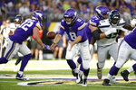 Minnesota Vikings quarterback Kirk Cousins (8) pitches the ball during the first half of an NFL preseason football game against the Seattle Seahawks, Sunday, Aug. 18, 2019, in Minneapolis. (AP Photo/Bruce Kluckhohn)